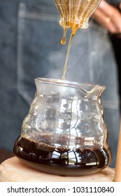 Filtered siphon coffee dropping into the coffee jar