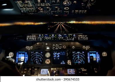Final approach at night - landing of a jet airliner, view from the cockpit