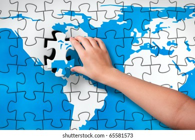 Final piece childs hand inserting missing stock illustration childs hand inserting missing piece of jigsaw puzzle world map into the gumiabroncs Image collections