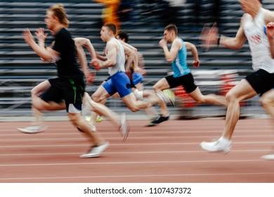 final running men sprinters runners in 100 meters blurred motion