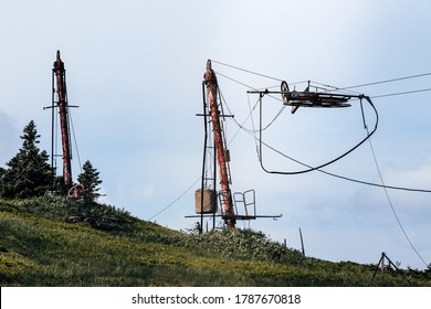 Final stop on the lift. Forgotten ski resort in Hruby Jesenik. Rusty pole with rope at anchor and driving people to the top of the mountain. Nature reserve. Lift abandoned. Czech republic. - Shutterstock ID 1787670818