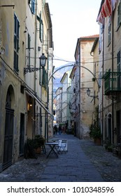 Finalborgo (SV), Italy - December 12, 2017: A typical house and pathway in Finalborgo village, Finale Ligure, Liguria, Italy