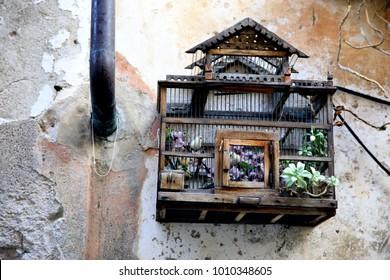 Finalborgo (SV), Italy - December 12, 2017: A bird cage in Finalborgo village, Finale Ligure, Liguria, Italy