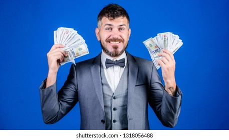 Finally rich. Business startup loan. Currency broker with bundle of money. Bearded man holding cash money. Rich businessman with us dollars banknotes. Making money with his own business.
