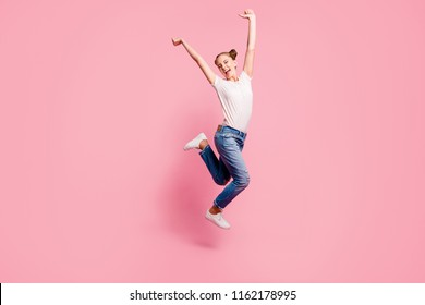 Finally summer vacation! Full legs, body, size portrait of happy girl who jumps up high lifting hands isolated on bright pink background