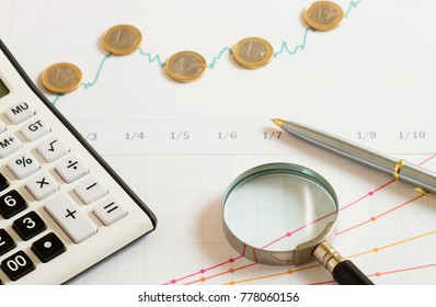 finance background with calculator and magnifier
