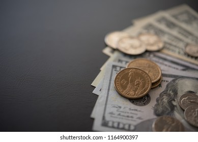 finance and banking concept. dollar money and coin dollar on black desk background. top view with copy space.