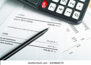 Finance and budget concept. Calculator, pen and accounting document on office table
