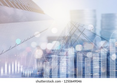 Finance and business investment concept. Double exposure of graph, rows of coins and business buildings the city for financial background or world economic report and presentation