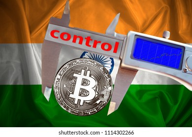 Finance concept, Bitcoin on the background a Flag  of India, bitcoin control, bitcoin in a caliper, a board with a trend of crypto currency