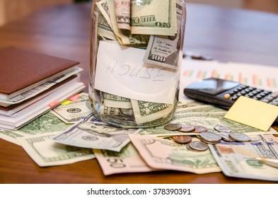 finance concept - money, notebook, pen