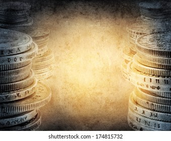 Finance concept. Old silver coins on vintage background.