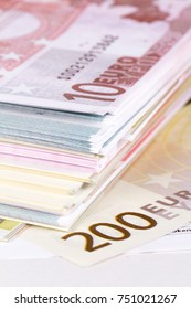 Finance concept, stack of euro banknotes and cash money.