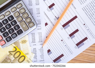 Finance concept, two hundred euro banknotes with pencil and calculator on graph chart analytics.
