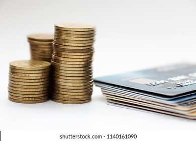 Finance concept,stack of currency coin and credit card on the desk.