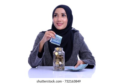 Finance conceptual. Pretty woman count or looks confident with money note