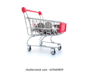 Finance Conceptual,Coins in shopping trolley isolated on white background