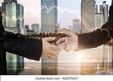 Finance data concept. ,Two Businessman  handshake ,The crisis for business cooperation. technical bar chart and city background.
