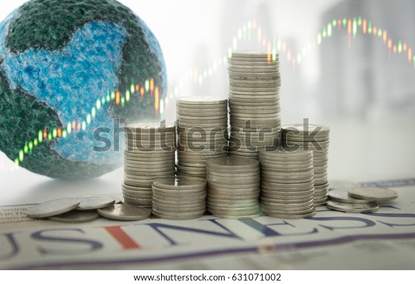 Finance economy world concept. Money stack on business newspaper with mock up globe, investment graph.