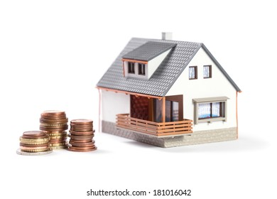 Finance and house expenses or investing concept. Beautiful house with coins.