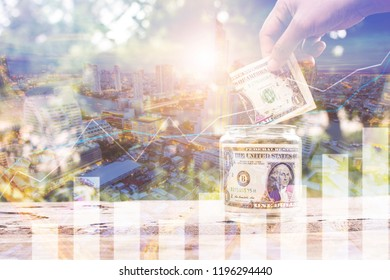 Finance and investment concept, double exposure of hand holding dollar banking note on jars with graph line dollar banking note on jars with night city