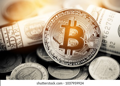 Finance investment risk concept: Stack of cryptocurrencies or bitcoin, Thai coin and US Dollar bill together. Cryptocurrency can uses designed as exchange on internet web markets.