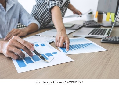 Finance manager presenting and discussing company growth project success financial statistics, professional investor working start up project for strategy plan with document.