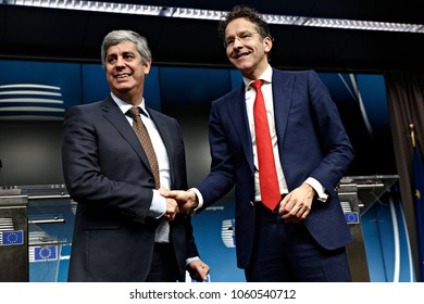 Finance Minister Mario Centeno and newly elected President of the Eurogroup is congratulated by outgoing Eurogroup President Jeroen Dijsselbloem in Brussels, Belgium, December 4, 2017