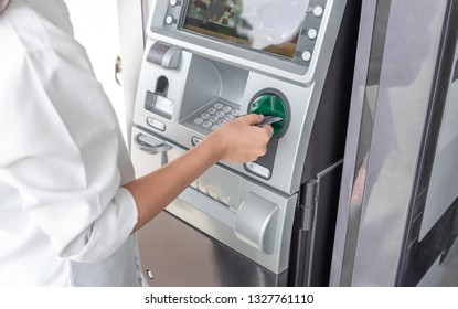 Finance, money, bank and people concept - close up of hands choosing option on atm machine
