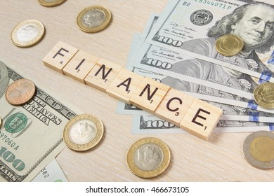 Finance. Money dollars euro cents on wooden table desk background with copy space for ad text