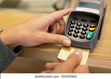 finance, money, technology, payment and people concept - close up of hand inserting bank card to terminal