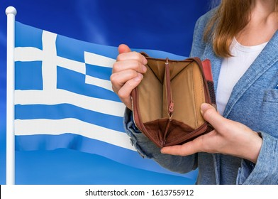 Finance problem in Greece. Poor person with empty wallet on national flag background.