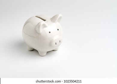 Finance, saving money, white piggy bank on seamless white background.
