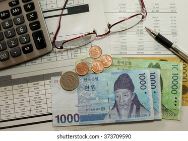 finance sheet with korean money and calculator as background.