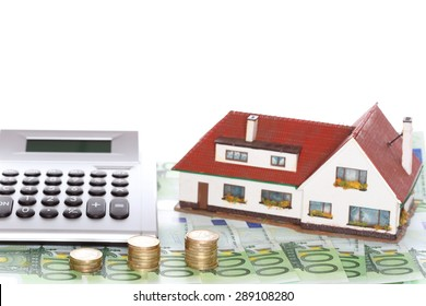finance symbol with calculator and house and money