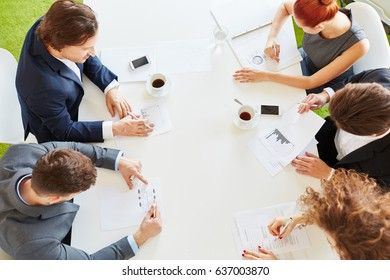 Finance team with statistics in business meeting