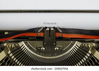 Finance word printed on an old typewriter