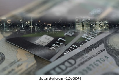 Finance,Money,Banking concept. Credit card,money with business city background.