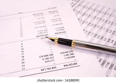 Finances and balances with pen