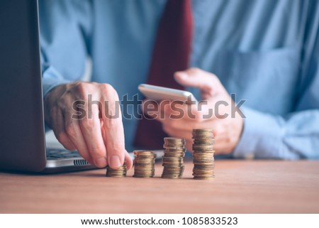 finances budgeting businessman stacking coins on stock photo edit