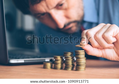 finances budgeting careful businessman stacking coins stock photo