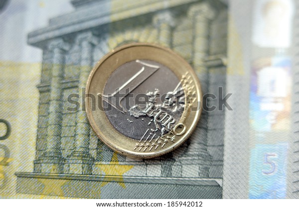 Finances. Euro coin on the table