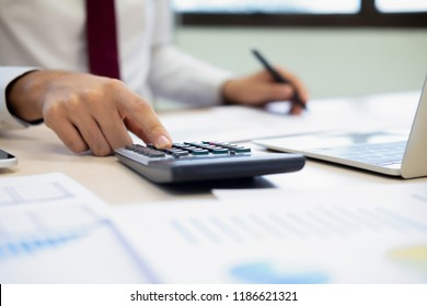 Finances Saving Economy concept. Male accountant or banker calculate the cash bill.