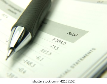 Finances statement with pencil