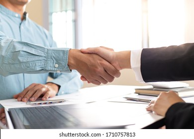 Financial accountants and marketers shaking hand to congratulate the double-digit real estate performance, Meetings and hand shake concept.