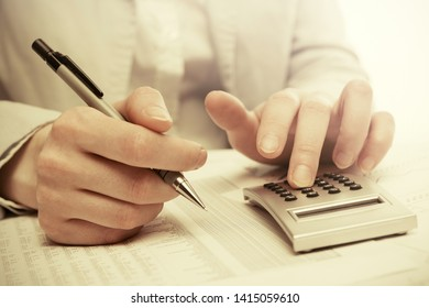 Financial accounting business woman using calculator in office
