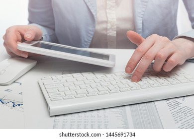 Financial accounting Business woman using digital tablet and computer keyboard in office