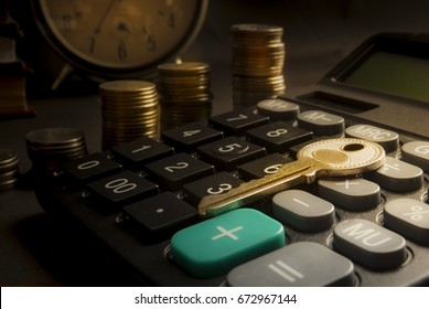 Financial accounting for Home loans,Keys and money calculator on table