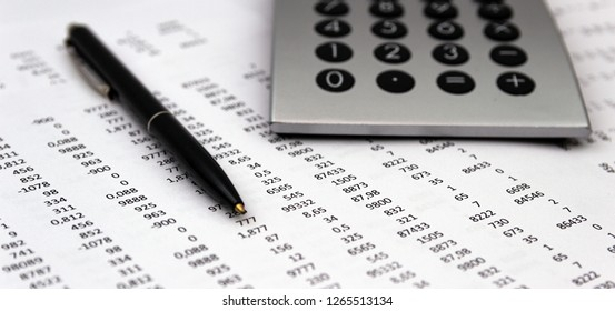 Financial accounting, Image a plurality of numbers on paper and calculator, Numbers on paper, a pen and a calculator.