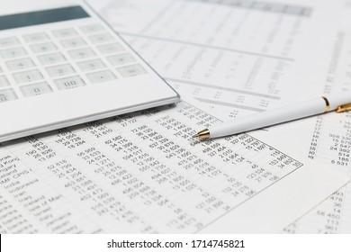 Financial accounting Pen and calculator on balance sheets